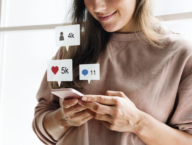 Woman using a smartphone social media conecpt